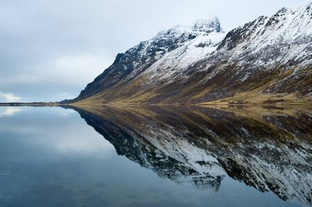 Mountain and mirror in Norway on Lofoten islands