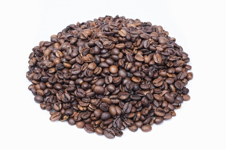 Roasted Coffee beans heap isolated on white background