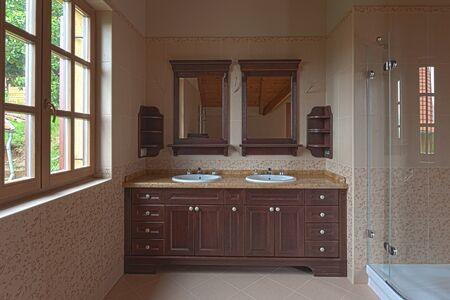 Bathroom in a luxury new house with window Фото со стока