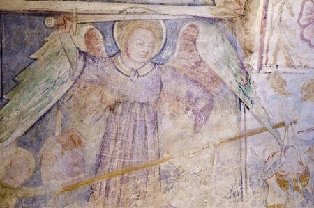 Fresco detail on the wall in the church Velemér, Hungary Редакционное