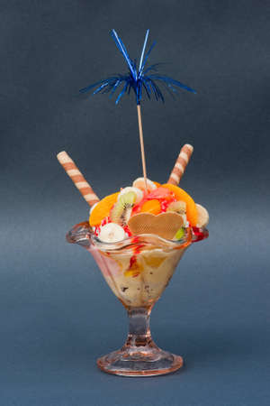 Ice sundae on gray background photo
