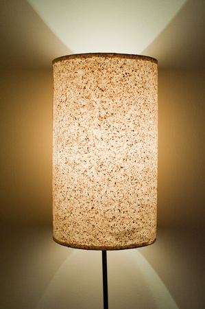 A close up frame of a Standing lamp with lights on the wall photo