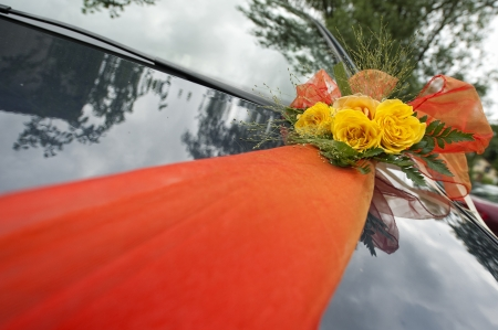 Bridal Bouquet on the Car with ribbon photo
