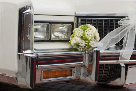 White oldtimer cadillac with flower