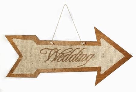 Burlap wedding sign arrow on the wood