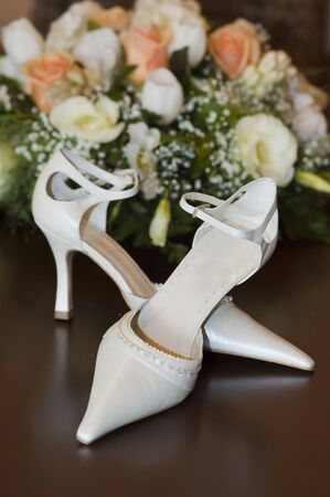 Wedding bouquet and shoes. Sharpness is on the shoes photo