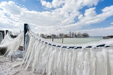 Ice on the chain on the shore of Lake Balaton photo
