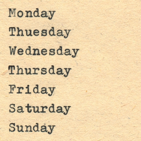 Days of the week are written by a typewriter on old paper  Фото со стока