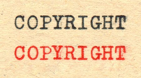 Copyright written by a typewriter on old paper  photo