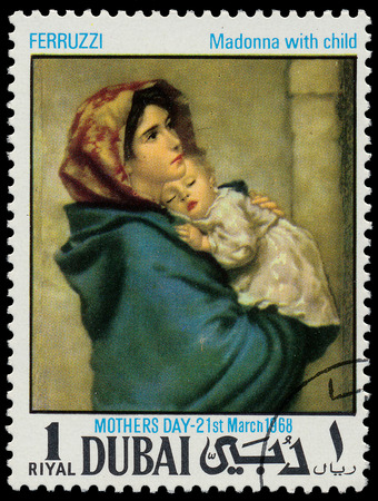 famous painting: DUBAI - CIRCA 1968  A stamp printed in Dubai shows painting of Roberto Ferruzzi - Madonna with child, series, circa 1968  Editorial