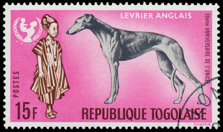 TOGO - CIRCA 1967: A stamp printed by Togo, shows The 20th Anniversary of UNICEF and Greyhound dog - Levrier Anglais, circa 1967  Editorial