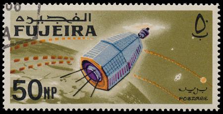 FUJEIRA - CIRCA 1966: A stamp printed in Fujeira (UAE) shows Space Achievements, circa 1966