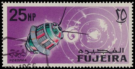 fujeira: FUJEIRA - CIRCA 1966: A stamp printed in Fujeira (UAE) shows Space Achievements, circa 1966