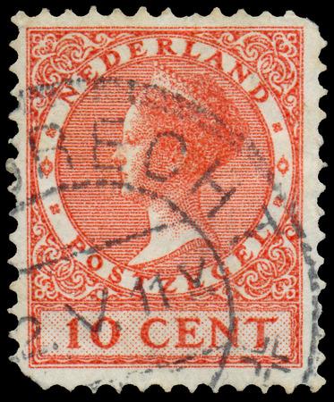 wilhelmina: NETHERLANDS - CIRCA 1924: A stamp printed in the Netherlands shows Queen Wilhelmina, circa 1924.  Stock Photo