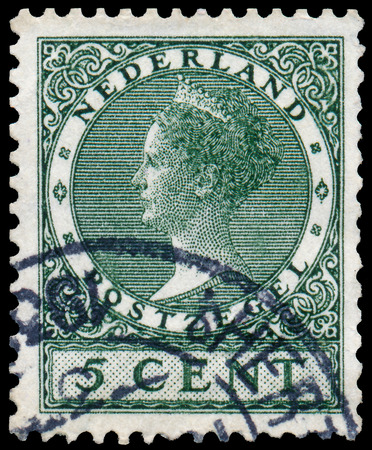NETHERLANDS - CIRCA 1924: A stamp printed in the Netherlands shows Queen Wilhelmina, circa 1924.  Stock Photo