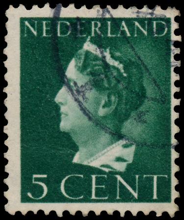 wilhelmina: NETHERLANDS - CIRCA 1940: A stamp printed in the Netherlands shows Queen Wilhelmina, circa 1940.