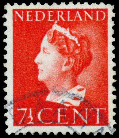 regnant: NETHERLANDS - CIRCA 1940: A stamp printed in the Netherlands shows Queen Wilhelmina, circa 1940.