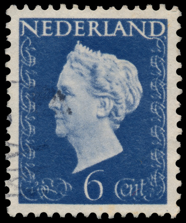 regnant: NETHERLANDS - CIRCA 1947: A stamp printed in Netherlands shows portrait of Queen Wilhelmina - Queen regnant of Netherlands Kingdom (1890 - 1948), wo inscription, series Queen Wilhelmina, circa 1947