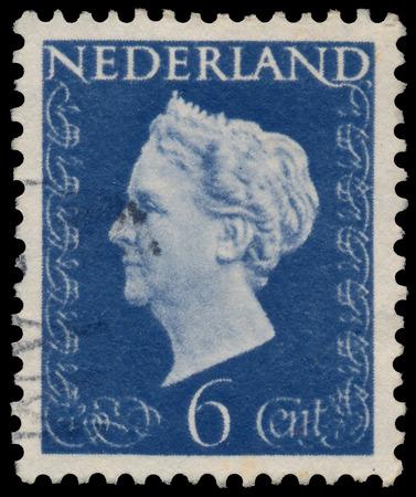 NETHERLANDS - CIRCA 1947: A stamp printed in Netherlands shows portrait of Queen Wilhelmina - Queen regnant of Netherlands Kingdom (1890 - 1948), wo inscription, series Queen Wilhelmina, circa 1947