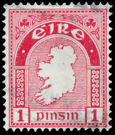 IRELAND - CIRCA 1922  Postage stamp printed in Ireland shows a map of the country, circa 1922  photo
