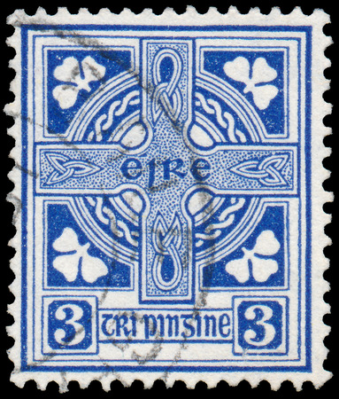 combines: IRELAND-CIRCA 1922  A stamp printed in Ireland shows image of Celtic cross is a symbol that combines a cross with a ring surrounding the intersection, circa 1922