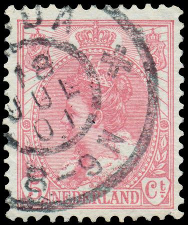 wilhelmina: NETHERLANDS - CIRCA 1899  A stamp printed in the Netherlands shows Queen Wilhelmina, circa 1899