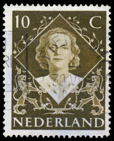 regnant: NETHERLANDS - CIRCA 1948  A stamp printed in Netherlands shows portrait of Queen Juliana  1909-2004  was the Queen regnant of the Kingdom of the Netherlands, circa 1948 Editorial