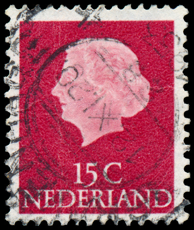 regnant: NETHERLANDS - CIRCA 1953  A stamp printed in Netherlands shows portrait of Queen Juliana  1909-2004  was the Queen regnant of the Kingdom of the Netherlands, circa 1953  Editorial