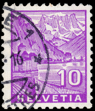SWITZERLAND - CIRCA 1934: A stamp printed in Switzerland, shows Chillon Castle and Dents du Midi, without inscription, from the series Landscapes&qu ot;, circa 1934 photo