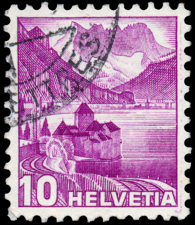 chillon: SWITZERLAND-CIRCA 1936:A stamp printed in SWITZERLAND shows image of The Chateau de Chillon (Chillon Castle) is located on the shore of Lake Leman in the commune of Veytaux, Switzerland, circa 1936.