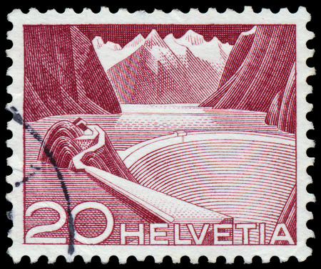 SWITZERLAND - CIRCA 1949: A stamp printed in Switzerland shows Grimsel Reservoir, circa 1949.  photo