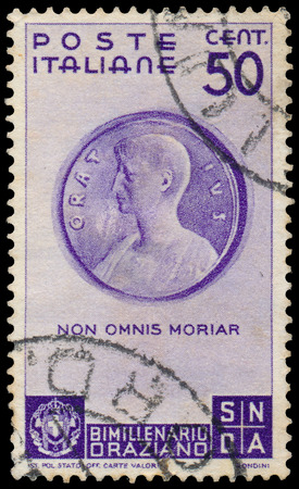 horace: ITALY - CIRCA 1936: A stamp printed in Italy shows Medallion with Horace (Museo di Cracovia), inscript Non omnis morinar - I shall not altogether die, circa 1936