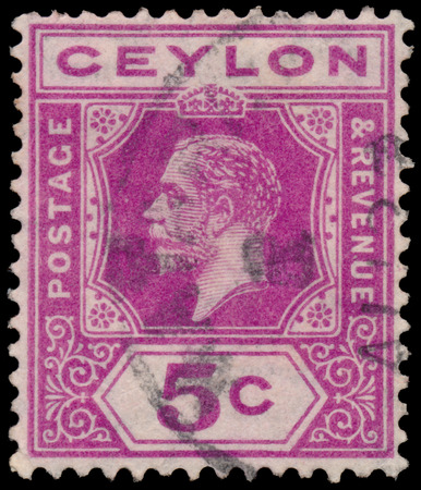 dominions: CEYLON - CIRCA 1911: A stamp printed in CEYLON shows image of the George V was King of the United Kingdom and the Dominions of the British Commonwealth, circa 1911.