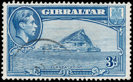 dominions: GIBRALTAR - CIRCA 1938: A stamp printed in GIBRALTAR shows image of the George VI (Albert Frederick Arthur George) was King of the United Kingdom and the Dominions of the British Commonwealth, circa 1938.