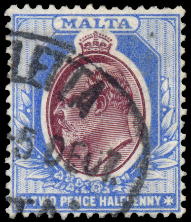 dominions: MALTA - CIRCA 1903: A stamp printed in MALTA shows image of the George V was King of the United Kingdom and the Dominions of the British Commonwealth, circa 1903. Editorial