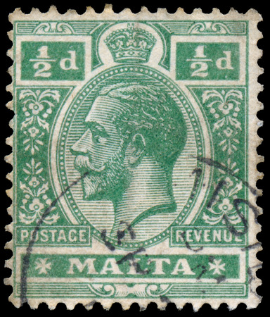 dominions: MALTA - CIRCA 1914: A stamp printed in MALTA shows image of the George V was King of the United Kingdom and the Dominions of the British Commonwealth, circa 1914.