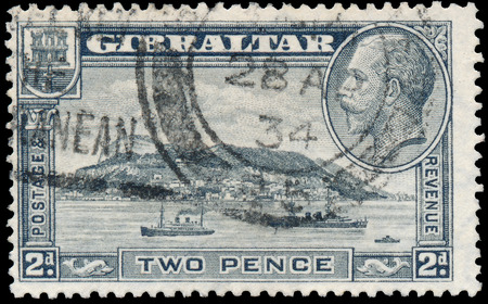 dominions: GIBRALTAR - CIRCA 1931: A stamp printed in GIBRALTAR shows image of the George V was King of the United Kingdom and the Dominions of the British Commonwealth, circa 1931.