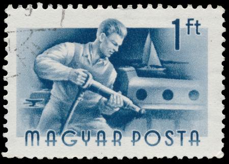 circa: HUNGARY - CIRCA 1955: A stamp printed in Hungary, shows shipbuilder, series occupations, circa 1955
