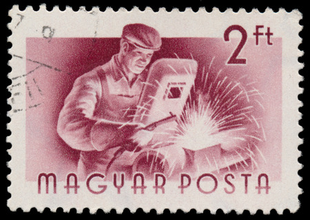 printed work: HUNGARY - CIRCA 1955: A stamp printed in Hungary, shows Welder, series occupations, circa 1955