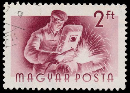 circa: HUNGARY - CIRCA 1955: A stamp printed in Hungary, shows Welder, series occupations, circa 1955