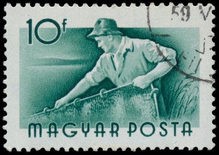 circa: HUNGARY - CIRCA 1955: A stamp printed in Hungary, shows Fisherman, series occupations, circa 1955 Stock Photo