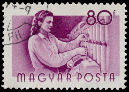 circa: HUNGARY - CIRCA 1955: A stamp printed in Hungary, shows Weaver, series occupations, circa 1955 Stock Photo