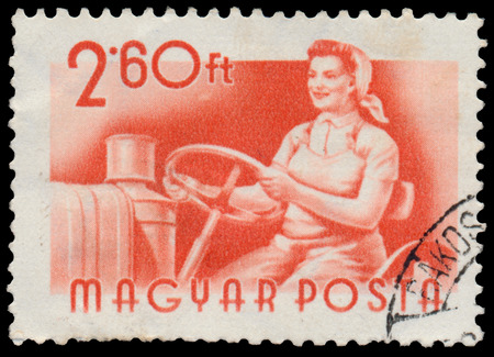 circa: HUNGARY - CIRCA 1955: A stamp printed in Hungary, shows tractor driver, series occupations, circa 1955