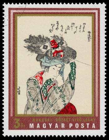 circa: HUNGARY - CIRCA 1971: stamp printed in Hungary shows Girl with fagot by Hokusai, the same inscription, series Japanese Prints from Museum of East Asian Art, Budapest, circa 1971