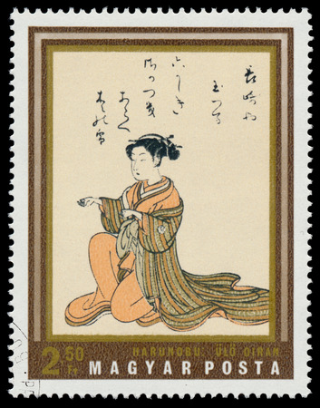 circa: HUNGARY - CIRCA 1971: stamp printed in Hungary shows seated courtesan, by Harunobu, the same inscription, series Japanese Prints from Museum of East Asian Art, Budapest, circa 1971 Stock Photo