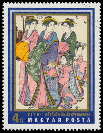 circa: HUNGARY - CIRCA 1971: stamp printed in Hungary shows walking women and children (by Eishi), the same inscription, series Japanese Prints from Museum of East Asian Art, Budapest, circa 1971 Stock Photo