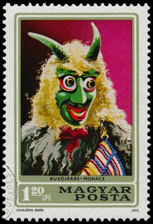 farsang: HUNGARY - CIRCA 1973: A stamp printed in Hungary shows Busojaras from town Mohacs, circa 1973 Editorial