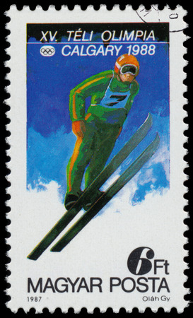 HUNGARY - CIRCA 1987: a stamp printed in the Hungary shows jump from a springboard, 1988 Winter Olympics, Calgary, Canada, circa 1987