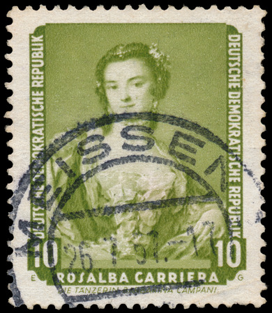 famous paintings: DDR - CIRCA 1957: A stamp printed in DDR shows the painting The dancer Barbaina Campani, by Rosalba Carriera , from the series Famous Paintings from Dresden Gallery, circa 1957. Editorial