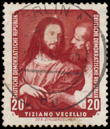 ddr: DDR - CIRCA 1957: A stamp printed in DDR shows the painting Tax coppers, by Tiziano Vecellio , from the series Famous Paintings from Dresden Gallery, circa 1957.